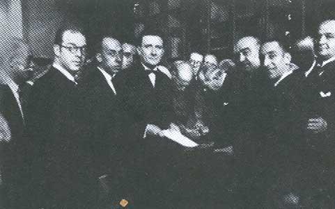 1931.  Francesc de Sales Aguiló, Emili Darder, el ministre del govern republicà Lluís Nicolau d'Olwer a l'acte d'entrega del castell de Bellver a la ciutat, a l'esquerra de l'imatge Francesc Julià.